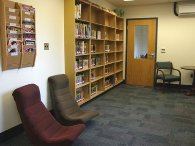 Library/Reading Room: New carpeting, curtains, and ceiling tile brighten the library. The reading nook gives students a place to relax and read in a comfortable, homier atmosphere.