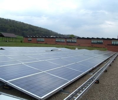 Photovoltaic Panels and a brand new 30-year warranted asphalt roof, with additional insulation, top the six acres of rooftops at the two schools.